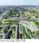 Купить «Aerial city view with crossroads and roads, houses, buildings, parks and parking lots. Sunny summer panoramic image», фото № 28750719, снято 15 июля 2018 г. (c) Александр Маркин / Фотобанк Лори