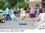 Купить «Tyumen, Russia, on July 15, 2018: the Russian girl rides a giroskuter in the summer on the square», фото № 28751747, снято 15 июля 2018 г. (c) Землянникова Вероника / Фотобанк Лори