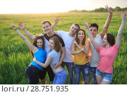 Купить «Group of young people on the field», фото № 28751935, снято 6 мая 2018 г. (c) Типляшина Евгения / Фотобанк Лори