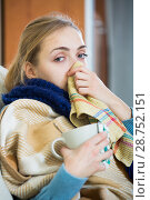Купить «Young woman suffering of cold and having stuffy nose», фото № 28752151, снято 19 июля 2018 г. (c) Яков Филимонов / Фотобанк Лори