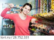 Купить «Woman in sweets shop», фото № 28752331, снято 22 марта 2017 г. (c) Яков Филимонов / Фотобанк Лори