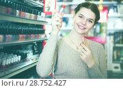 Купить «Adult female searching for reliable lipstick», фото № 28752427, снято 21 февраля 2017 г. (c) Яков Филимонов / Фотобанк Лори
