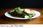 Купить «Fried zucchini seasoned with dill», видеоролик № 28753483, снято 16 июля 2018 г. (c) Peredniankina / Фотобанк Лори