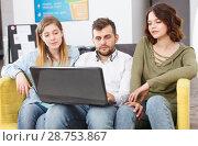 Купить «Young people with laptop», фото № 28753867, снято 24 мая 2018 г. (c) Яков Филимонов / Фотобанк Лори