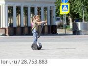 Купить «Tyumen, Russia, on July 16, 2018: the Russian girl rides a giroskuter in the summer in the park», фото № 28753883, снято 16 июля 2018 г. (c) Землянникова Вероника / Фотобанк Лори
