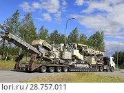 Купить «100 000 kg heavy transport of Metso Lokotrack crusher by semi trailer of Telamurska Oy on the move on freeway rest area. Salo, Finland - June 30, 2018.», фото № 28757011, снято 30 июня 2018 г. (c) age Fotostock / Фотобанк Лори