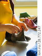 Купить «Handmade shoes. The process of making fashionable and stylish shoes from natural felted wool.», фото № 28772247, снято 31 января 2018 г. (c) Сергей Лабутин / Фотобанк Лори