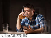 Купить «man with cellphone drinking alcohol and smoking», фото № 28773187, снято 24 ноября 2017 г. (c) Syda Productions / Фотобанк Лори