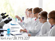 Купить «kids with test tubes studying chemistry at school», фото № 28773227, снято 19 мая 2018 г. (c) Syda Productions / Фотобанк Лори