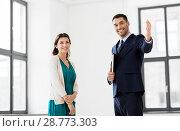 Купить «realtor showing new office room to female customer», фото № 28773303, снято 8 июня 2018 г. (c) Syda Productions / Фотобанк Лори