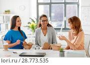 Купить «happy businesswomen eating take out food at office», фото № 28773535, снято 17 марта 2018 г. (c) Syda Productions / Фотобанк Лори