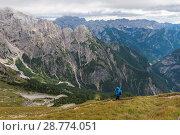 Купить «Lonely tourist in the Julian Alps, Slovenia», фото № 28774051, снято 19 сентября 2016 г. (c) Игорь Овсянников / Фотобанк Лори