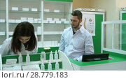Купить «Team of pharmacists having conflict at the hospital pharmacy», видеоролик № 28779183, снято 6 апреля 2017 г. (c) Vasily Alexandrovich Gronskiy / Фотобанк Лори