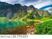 Купить «a small beautiful mountain lake Czarny Staw in the high Tatras on the territory of Poland», фото № 28779651, снято 18 августа 2017 г. (c) Константин Лабунский / Фотобанк Лори
