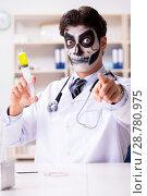Купить «Scary monster doctor working in lab», фото № 28780975, снято 9 ноября 2017 г. (c) Elnur / Фотобанк Лори