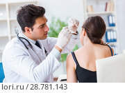 Купить «Doctor checking patients ear during medical examination», фото № 28781143, снято 28 февраля 2018 г. (c) Elnur / Фотобанк Лори
