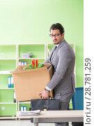 Купить «Male employee collecting his stuff after redundancy», фото № 28781259, снято 14 мая 2018 г. (c) Elnur / Фотобанк Лори