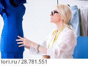 Купить «Woman tailor working on new dress designs», фото № 28781551, снято 13 апреля 2018 г. (c) Elnur / Фотобанк Лори