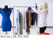 Купить «Woman tailor working on new dress designs», фото № 28781555, снято 13 апреля 2018 г. (c) Elnur / Фотобанк Лори