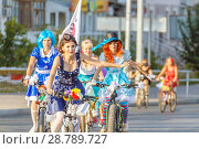 Купить «Beautiful smart girls ride bicycles through the streets of the city. Traditional bike ride dressed up girls.», фото № 28789727, снято 20 августа 2017 г. (c) Акиньшин Владимир / Фотобанк Лори
