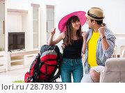 Купить «Young active pair preparing for honeymoon trip», фото № 28789931, снято 30 апреля 2018 г. (c) Elnur / Фотобанк Лори