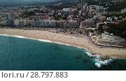 Купить «Picturesque aerial view of Mediterranean coastal town of Lloret de Mar in Catalonia, Spain», видеоролик № 28797883, снято 11 июня 2018 г. (c) Яков Филимонов / Фотобанк Лори