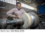 Купить «Spoon-Making Factory Workers at a steel recycling and steel spoon making factory in Dhaka. Many child labors are working a spoon factory at Hajaribag near...», фото № 28802039, снято 13 декабря 2017 г. (c) age Fotostock / Фотобанк Лори