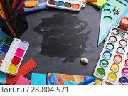 Купить «School stationery on background blackboard», фото № 28804571, снято 25 декабря 2017 г. (c) Майя Крученкова / Фотобанк Лори