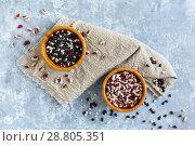 Купить «Different types of beans in wooden bowls», фото № 28805351, снято 26 июня 2018 г. (c) Марина Сапрунова / Фотобанк Лори