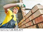 Купить «bricklaying. Construction worker building a brick wall», фото № 28805471, снято 30 марта 2018 г. (c) Дмитрий Калиновский / Фотобанк Лори