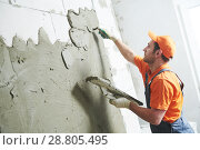 Купить «Renovation at home. Plasterer spreading plaster on wall.», фото № 28805495, снято 2 апреля 2018 г. (c) Дмитрий Калиновский / Фотобанк Лори
