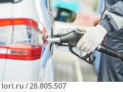 Купить «Fuelling diesel fuel into automobile at filling station», фото № 28805507, снято 17 апреля 2018 г. (c) Дмитрий Калиновский / Фотобанк Лори