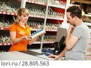 Купить «man shopping at hardware supermarket», фото № 28805563, снято 14 мая 2015 г. (c) Дмитрий Калиновский / Фотобанк Лори