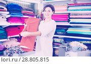 Купить «Woman choosing fabric», фото № 28805815, снято 4 января 2017 г. (c) Яков Филимонов / Фотобанк Лори
