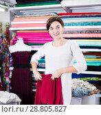 Купить «Woman testing fabric quality», фото № 28805827, снято 4 января 2017 г. (c) Яков Филимонов / Фотобанк Лори