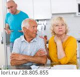 Купить «Upset man and woman quarrelling at home, son on background», фото № 28805855, снято 18 июня 2018 г. (c) Яков Филимонов / Фотобанк Лори