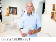 Купить «Man visiting painting exhibition», фото № 28805931, снято 9 июня 2018 г. (c) Яков Филимонов / Фотобанк Лори
