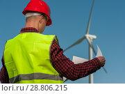 Concept of engineers and windmills. Стоковое фото, фотограф Pavel Biryukov / Фотобанк Лори