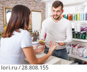 Купить «Young man specialist advise girl client in cosmetics studio», фото № 28808155, снято 25 апреля 2018 г. (c) Яков Филимонов / Фотобанк Лори
