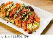 Купить «Image of salmon toast with lettuce, avocado and cheese», фото № 28808199, снято 24 июня 2018 г. (c) Яков Филимонов / Фотобанк Лори