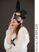 Купить «Sexy woman in bdsm leather mask and belts view», фото № 28809235, снято 16 июня 2018 г. (c) Гурьянов Андрей / Фотобанк Лори