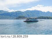 Купить «Tremezzo, Lake Como, Italy - July 6 2018: View of car ferry leaving Bellagio harbor in Bellagio», фото № 28809259, снято 6 июля 2018 г. (c) Григорий Стоякин / Фотобанк Лори