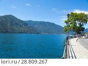 Купить «Lake Como, Italy - July 6 2018: View of Lake Como (northern Italy) in a sunny day», фото № 28809267, снято 6 июля 2018 г. (c) Григорий Стоякин / Фотобанк Лори
