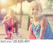 Купить «Portrait of happy girl outdoors», фото № 28820491, снято 20 июля 2017 г. (c) Яков Филимонов / Фотобанк Лори