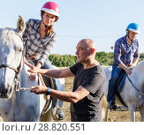 Купить «Trainer talking to female while riding horse at ranch», фото № 28820551, снято 4 июля 2018 г. (c) Яков Филимонов / Фотобанк Лори