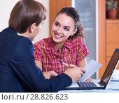 Купить «Insurance agent and customer discussing», фото № 28826623, снято 23 сентября 2018 г. (c) Яков Филимонов / Фотобанк Лори