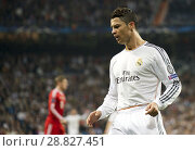 Купить «Cristiano Ronaldo in action during the UEFA Champions League semi final match between Real Madrid and Bayern Munich at Santiago Bernabeu stadium on April 23, 2014 in Madrid, Spain», фото № 28827451, снято 23 апреля 2014 г. (c) age Fotostock / Фотобанк Лори