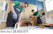 Купить «Two diligent teenagers boy works with tools in the workshop», видеоролик № 28833071, снято 21 февраля 2020 г. (c) Константин Шишкин / Фотобанк Лори