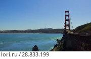 Купить «golden gate bridge over san francisco bay», видеоролик № 28833199, снято 9 июля 2018 г. (c) Syda Productions / Фотобанк Лори