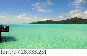 Купить «lagoon at tropical beach in french polynesia», видеоролик № 28833251, снято 3 июля 2018 г. (c) Syda Productions / Фотобанк Лори